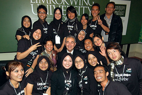 Tun Abdullah and wife with Limkokwing London students.